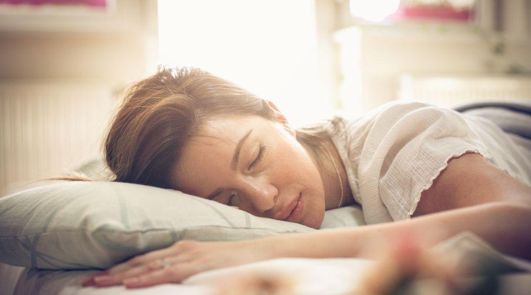 Woman sleeping peacefully - the importance of sleep