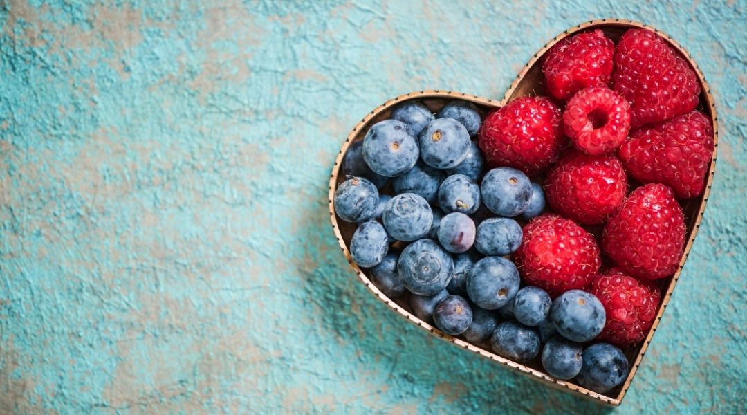 blueberries and raspberries arranged in a heart shaped cookie cutter - Nutrition tips